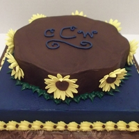 Denim & Sunflowers 9 inch petal / 10 inch square - white cakes covered and filled with buttercream. Sunflowers are gumpaste. The wedding theme/colors - denim...