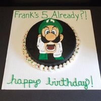 5 Already?! 8 inch round filled and frosted with chocolate buttercream. Luigi is royal icing.