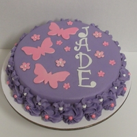 Glitter-Flies And Flowers Buttercream with fondant/gumpaste flowers and butterflies, gumpaste letters - all with pearl finish. Pink and white large dragees around...