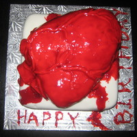 Bleeding Heart This cake was for a halloween birthday. The cake inside was red velvet to add to the effect.