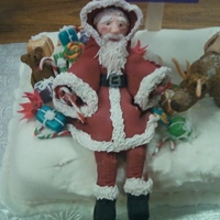 Santa Cake I made this cake for my son's kindergarten christmas party. The santa and reindeer are made from gumpaste . The snow is a combination...