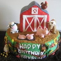 Farm Birthday 1st birthday farm cake. The animals, fence, and plants are a combination of gumpaste and fondant. The dirt is chocolate and graham cracker...