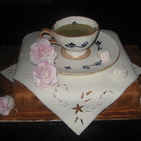 Tea Cup Cake This cake is entirely eddible. The cup is moulded out of gumpate and filled with royal icing. The table cloth, woograin and sugar cubes are...