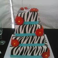 4 Tier Zebra Wedding Cake With Orange Gumpaste Gerber Daisies *4 tier zebra wedding cake with orange gumpaste Gerber Daisies