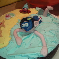 Snorkeling Cake  This is a chocolate cake filled with chocolate butter cream and decorated using coloured butter cream and fondant icing. This was also the...