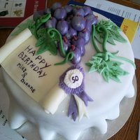 Grape Cake   Fruit cake ices with fondant and butter icing. for a joint 50th birthday party!