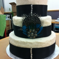First 3 Tier Cake Three tier buttercream with rock sugar.