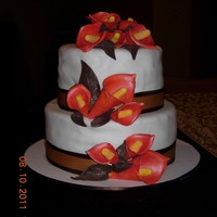 Burnt Orange Calla Lily My first Wedding cake. Thanks to cwlsims on how to get the color I was looking for.