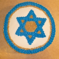 Star Of David   White cake w/ white icing. Blue is BC decorator's icing. Gold sprinkles.