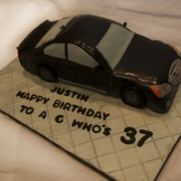 Infiniti G37 Cake Hi there! This cake was made for a guy who LOVES Infiniti cars. I carved a chocolate cake with chocolate buttercream and covered with...