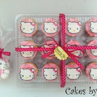 Hello Kitty Cupcakes A nice way to package cupcakes :) These are vanilla with vanilla SMBC. Hello Kitty made out of fondant. Visit us on Facebook: http://www....