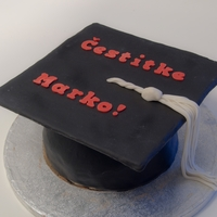 Graduation Hat A simple graduation cake, chocolate cake covered in black MMF.