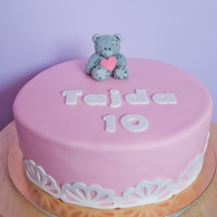 Me To You Teddy Bear Cake Raspberry cake for my niece's birthday. It is covered in fondant, the teddy bear is also made out of fondant.