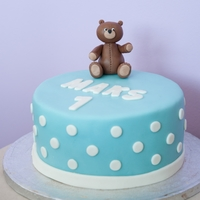 Teddy Bear Cake A teddy bear cake for a little boy's 1st birthday. Chocolate cake, covered in fondant, the teddy bear is made of modeling paste.