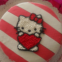 Hello Kitty Cake made with red and white fondant.