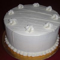 White Chocolate Cake Our White Chocolate Cake - Rich chocolate cake frosted with White Chocolate Buttercream, and drizzled with Ghiradelli White Chocolate. It&#...