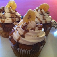 Banas Foster Cupcake Ohhh. . . yummm. We made Banan cake with very vanilla frosting, topped with rum caramel and pecans . . Very elegant dessert for the refined...