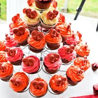1318468629.jpg First cupcakes, first wedding! Red velvet with cream cheese filling, cream cheese frosting ,and white chocolate hearts made to the bride&#...