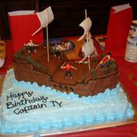 Pirate Ship Birthday Cake Vanilla rect. cake and chocolate ship...buttercream icing w/ fondant accents