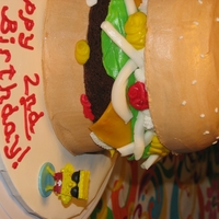 Hamburger Cake Bun was white cake. Hamburger made of brownie. Buttercream and fondant accents.
