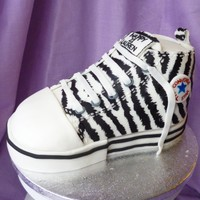 Converse Boot 21St Birthday Cake Converse Boot 21st Birthday CakeVanilla sponge with raspberry jam and vanilla buttercream fillingDecorated with fondant and royal icing