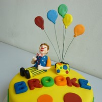 Mr Tumble Cake For Brooke Vanilla sponge with raspberry jam and vanilla buttercream filling Decorated with fondant icing and gumpaste