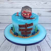 Shark Attack Cake This cake was ordered by a dad for his little boys 6th birthday, he asked if I could make a shark themed cake and could I make it Scary!...