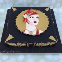 Art Deco Lady An Art Deco themed cake based on a series of greeting cards that the recipient is fond of. The lady is painted on to hand cut fondant, the...
