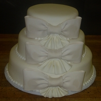 Gum Paste Bows With Pleated Ribbon Pound cake covered in marshmallow fondant. Bows are made of gum paste.
