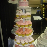 "Cupcake Stand Wedding Display 80 pink cupcakes, with a 7"" display cake on top."