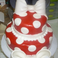Minnie Mouse Bows were made of gum paste, ears are made of fondant with toothpicks stuck to the back (with gum paste) so they would stay on the cake.