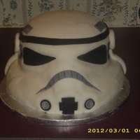 "Stormtrooper Helmet Made with four 8"" layers of yellow cake for the main part of the head, and rice krispy treats to make the 3-D parts (the mouth and..."