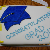 Graduation Cake My first fondant cake. It took some time but I think it turned out pretty well :)Simple vanilla cake and vanilla buttercream frosting...