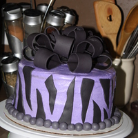 Wild About Purple This cakes makes me think of the Flinstones!