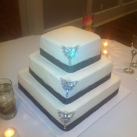 Black & White With Butterflies   Black & White square wedding cake with Butterfly brooches