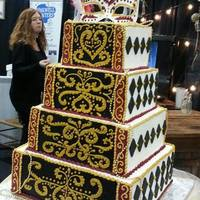 Masquerade Themed Wedding Cake Displayed At The 2014 Wedding Planner And Guide Bridal Show Made Mainly With Buttercream The Harlequin Di Masquerade themed wedding cake. Displayed at the 2014 Wedding Planner and Guide bridal show. Made mainly with buttercream. The harlequin...