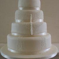 Lace Effect Wedding Cake ivory 3 tiered round cake with filigree icing to represent the brides dress
