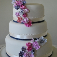 Sweet Pea Wedding Cake 3tier round wedding cake decorated with sugarcraft sweet peas