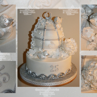 25Th Wedding Anniversary Birdcage base cake is Rich fruit covered in marzipan and fondant. Birdcage is vanilla sponge covered in fondant. All decorations are edible, having...