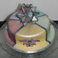 Stained Glass Effect Rich Fruit cake covered in Marzipan and fondant. The topper was built around a polystyrene ball with dried gumpaste pieces and finished off...
