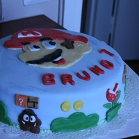 "Super Mario Cake I made this big Super Mario cake for 7 year old boy. He loved it! It was hard for me to do this ""new"" Mario because i'm used..."