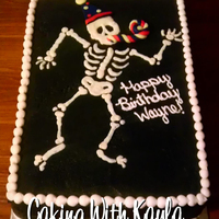 X-Ray Birthday Cake  This was made for a co-worker. It's oreo cake and is decorated with buttercream. I made the skeleton with white chocolate. The party...