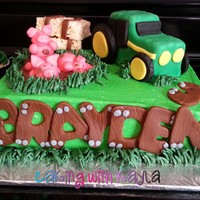 Tractor Birthday Cake   This is a tractor-themed birthday cake. The tractor is made with rice cripsy treats and the pigs are made with fondant.
