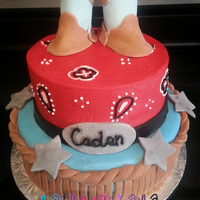 Western Birthday Cake  This is for a Western-themed birthday party. The bottom layer is decorated and covered with MMF. The top layer is decorated with...
