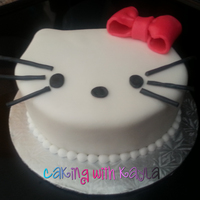 Hello Kitty  This is a Hello Kitty cake for a 3rd birthday party. I used an 8-inch round cake and cut it in the shape of Hello Kitty. Then I covered and...