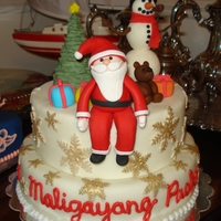 Maligayang Pasko - Merry Christmas! Gumpaste figures with fondant smowflakes painted with gold luster dust.