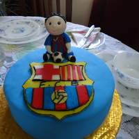 Sporty Cake F.C Barcelona Birthday Cake...... chocolate cake with chocolate ganache filling..... gumpaste lil soccer boy with fondant FCB logo