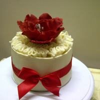 White Chocolate Ruffles And Wrap Cake Made With Pure White Couverture Chocolate Gumpaste Flower White chocolate ruffles and wrap cake, made with pure white couverture chocolate.... gumpaste flower....