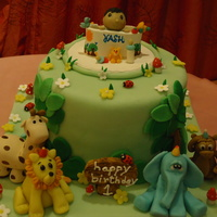 Jungle Theme Cake With A Lil Boy In His Play Penanimals Boy Made Of Gumpaste Rest Of The Details Made Of Fondant Cho Jungle theme cake.... with a lil boy in his play pen....animals , boy made of gumpaste.... rest of the details made of fondant............