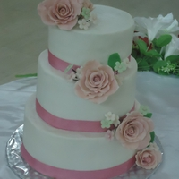 Roses this was my first wedding cake!.....strawberry cake with jam filling..buttercream frosting....gumpaste roses :)